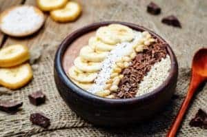 chocolate smoothie with banana, coconut, pine nuts, chocolate and sesame seeds. toning. selective focus